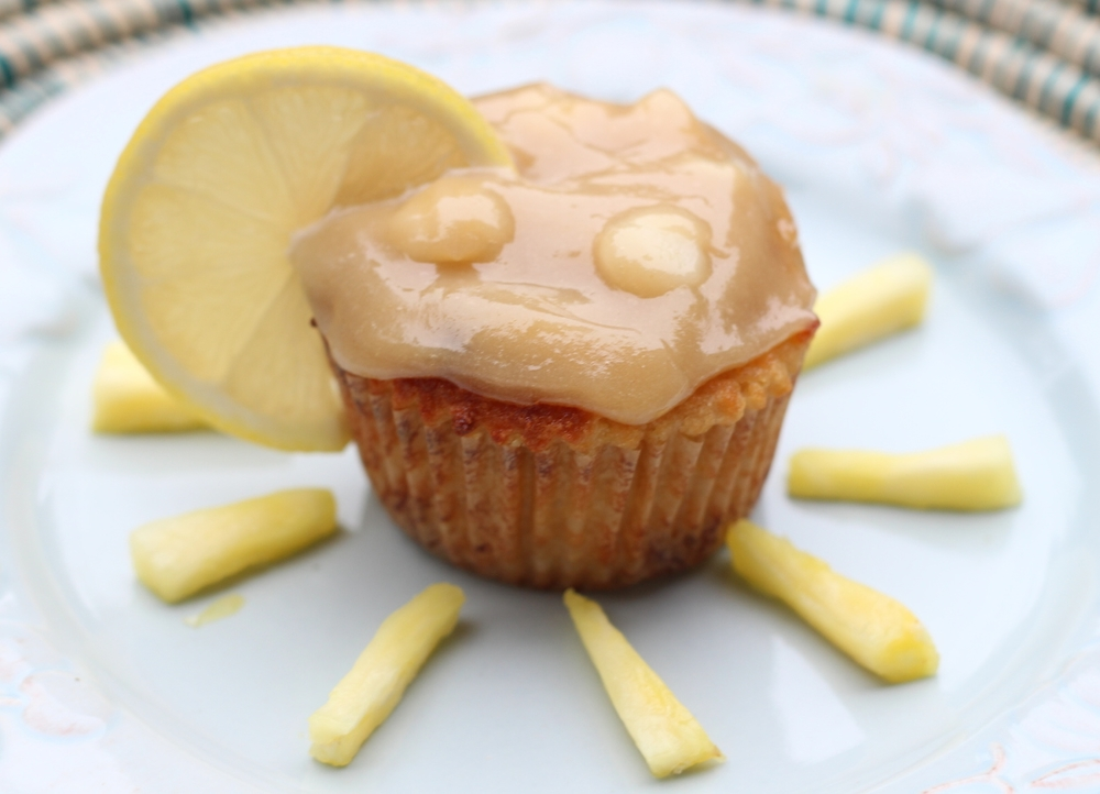 Pineapple-Coconut Muffins with Macadamia Nut Frosting